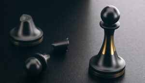 3D illustration of a broken pawn and another one repaired by using of a golden part. Black background. Positive psychology and resilience concept.